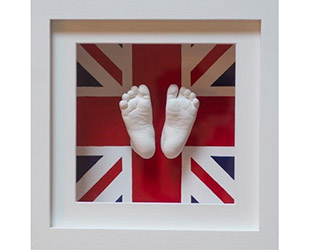 Baby plaster cast feet in a union jack frame